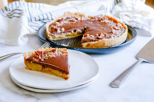 With a buttery graham cracker crust, a homemade caramel pecan filling, and a layer of rich ganache on top, this Turtle Pie is the dessert of your dreams. It's a must-make pie for the holiday season and absolutely irresistible