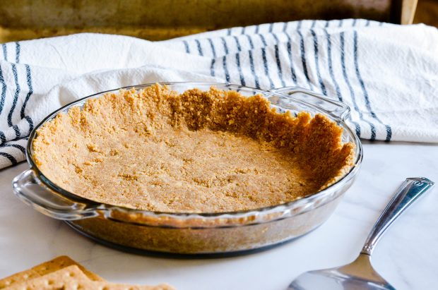 This perfect, delicious, buttery Graham Cracker Pie Crust is so simple to make and a must-have at your Thanksgiving pie table.