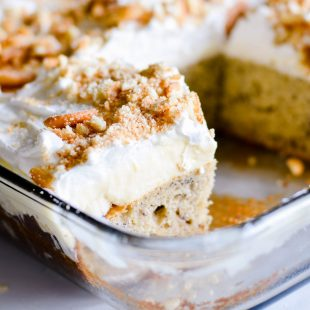 This homemade Banana Pudding Cake starts with a deliciously moist cake made with buttermilk. Then it's topped with classic layers of Southern banana pudding, whipped topping and finished with crumbled vanilla wafer cookies.
