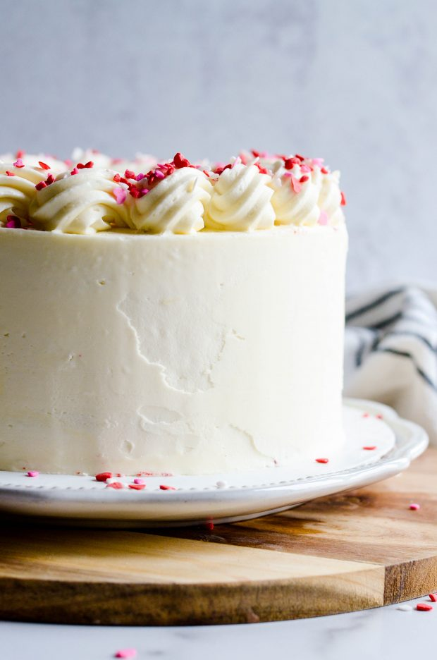 This Red Velvet Cake with White Chocolate has three layers of delicious, moist red velvet cake filled and frosted with white chocolate buttercream.