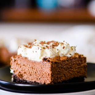 These French Silk Pie bars have a delicious chocolate graham cracker crust with a creamy, yet light-as-air, chocolate mousse filling.