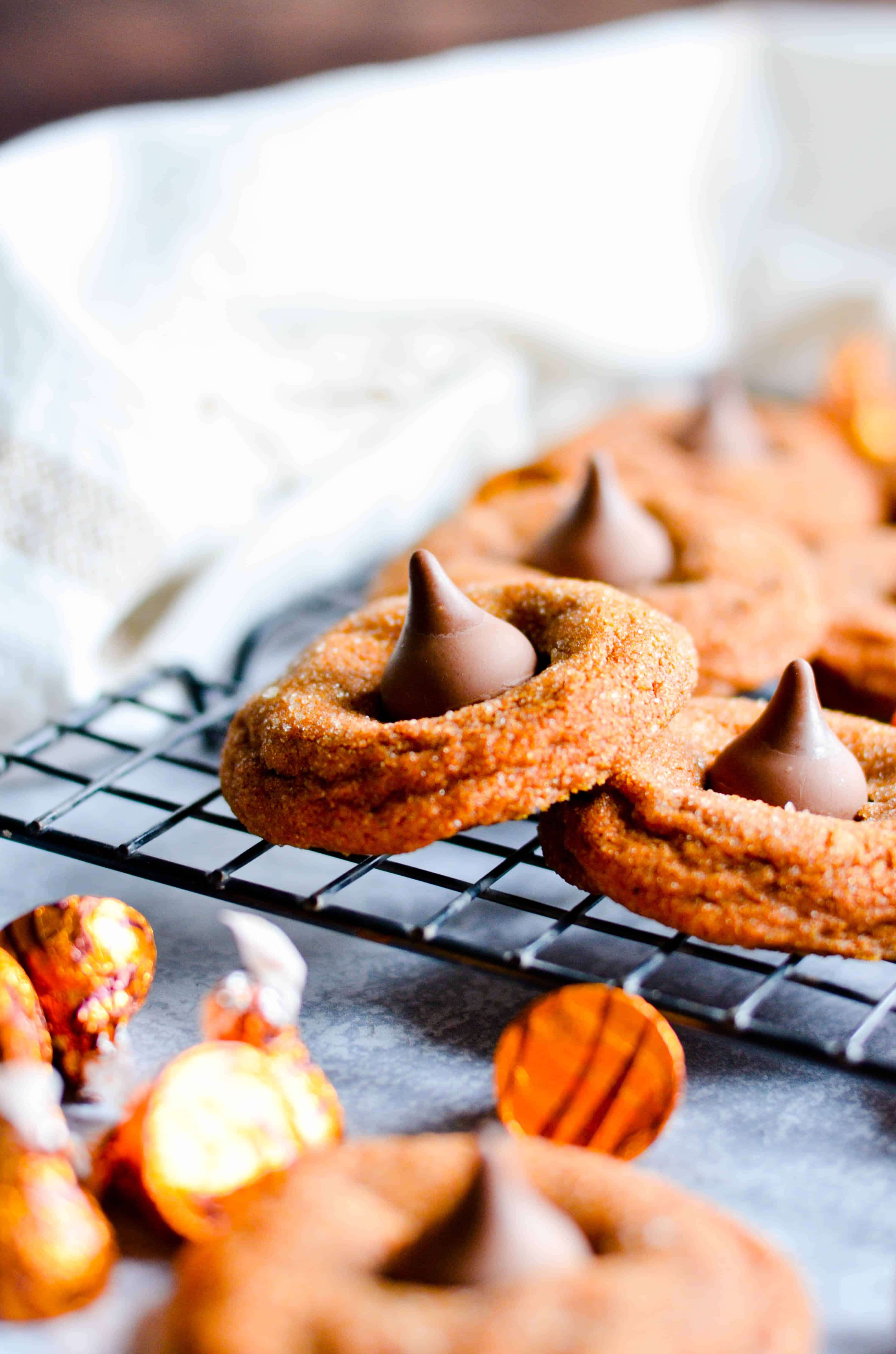 Pumpkin snickerdoodles with a caramel kiss pressed into the middle. These Pumpkin Caramel Kiss Cookies taste like Fall and are so yummy!